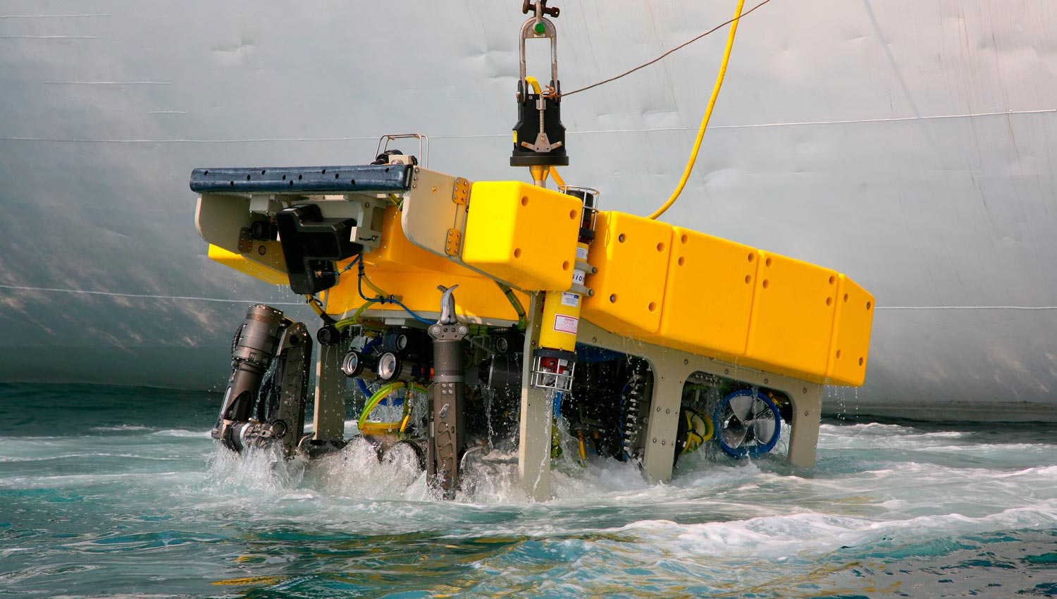 Marine robot being lowered into ocean